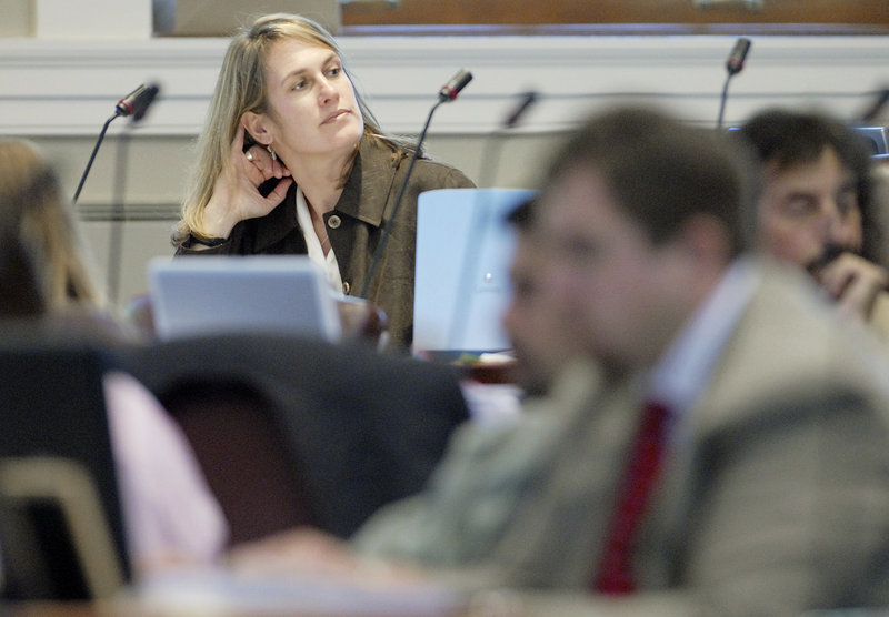 Cynthia Dill, then a state representative, listens to a debate in the Maine House in 2007. In Augusta, Dill sponsored measures to allow the recall of the governor and to ban nepotism in state government (both in response to actions by Gov. Paul LePage). She also spearheaded the creation of an expansion of broadband Internet in rural Maine.