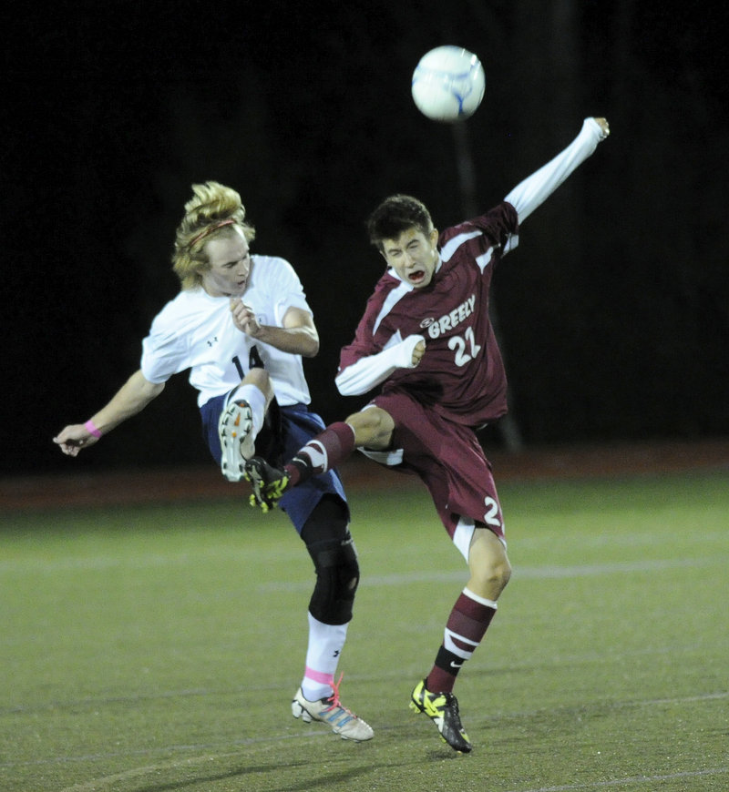 Ethan Cyr, left, of Yarmouth and Miles Shields of Greely are in perfect step as they compete for the ball during Greely's 2-0 victory in a Western Maine Conference game.
