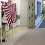 Mike Bradley fills in his absentee ballot in a voting booth in a hallway near the Augusta City Clerk's Office on Thursday morning. Absentee ballots may be requested until Nov. 1 and are accepted through Election Day.