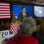 Supporters watch Republican vice presidential nominee Paul Ryan debate Vice President Joe Biden on TV in a Janesville, Wis., hotel. Ryan's record contradicts his current feelings about Obamacare and food stamps.