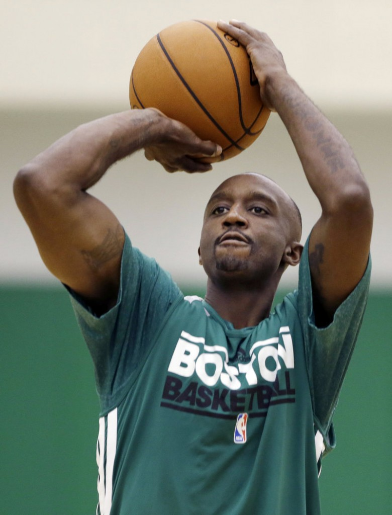 Jason Terry, a Dallas Maverick last season, practices shooting during Boston's preseason camp.