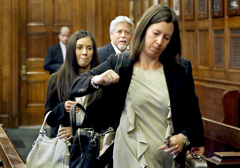Alexis Wright, left, leaves a Cumberland County courtroom with her attorney, Sarah Churchill, front, as Mark Strong Sr., center, talks with his lawyer after their arraignments in Portland on Oct. 9. Police plan to release the names of alleged clients in the prostitution case in which Wright and Strong are embroiled.