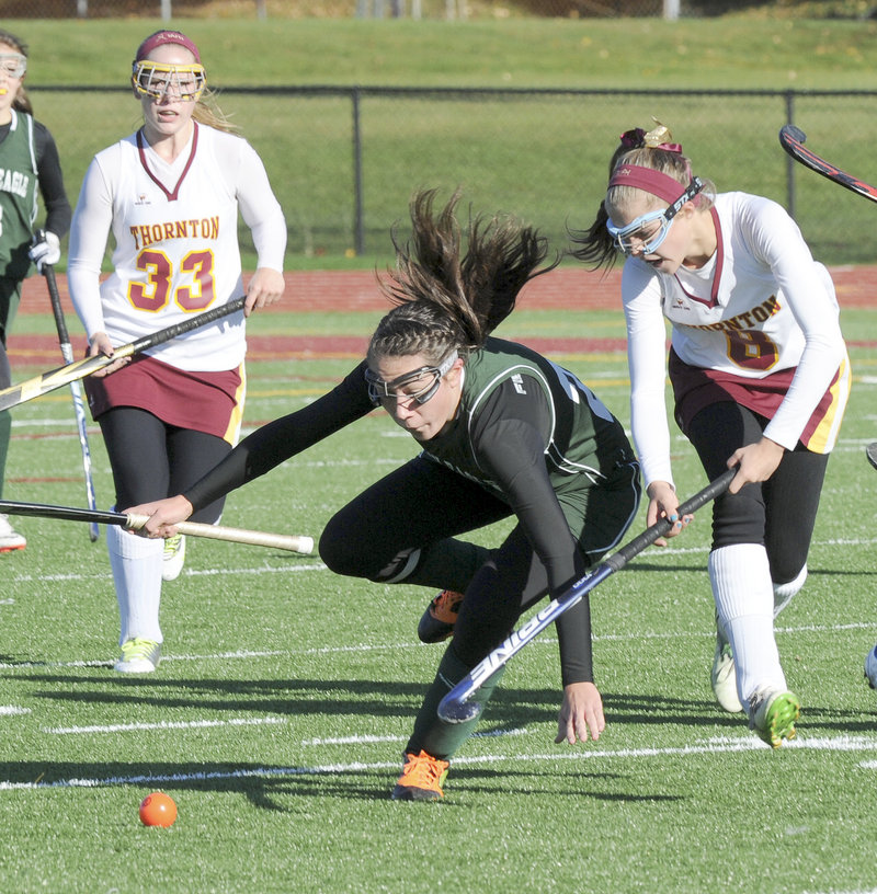 Cassidy Merrill of Bonny Eagle is tripped Saturday while competing with Libby Pomerleau of Thornton for the ball. At left for Thornton is Karen Jacques. Thornton won, 2-0.