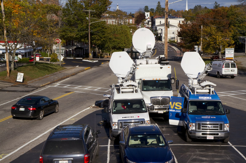 Several satellite trucks were stationed on Route 1 in Kennebunk on Tuesday, across the street from a former Zumba studio implicated in a prostitution scandal.