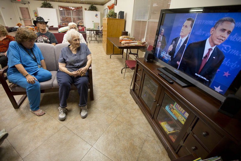 Residents of the Quail Ridge Manor independent living apartment comples in Boulder City, Nev., watch the presidential debate on Tuesday.