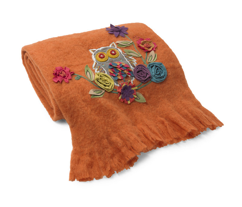 Appliqued flowers decorate a wool blend throw from HomeGoods.com.