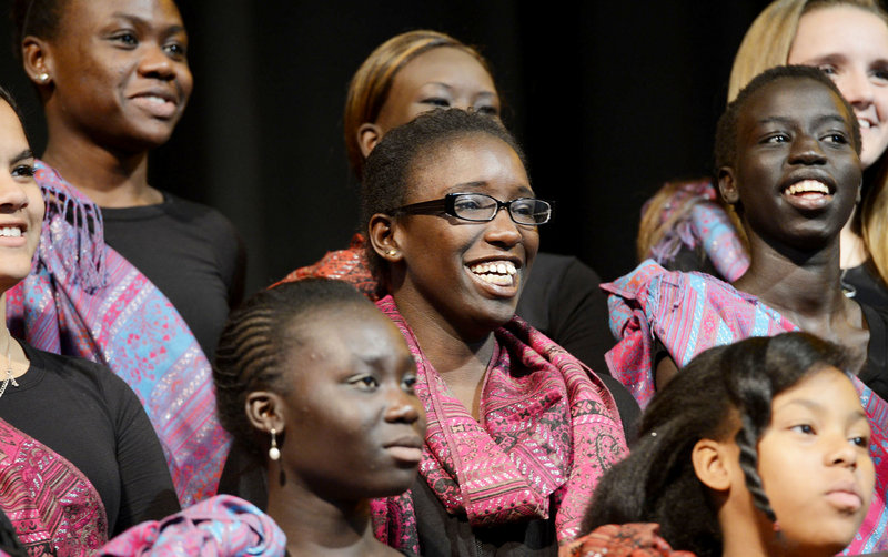 "Judith Abdalla, an immigrant from Sudan, prepares to perform ""Song for Malala"" with the Pihcintu Multicultural Children's Chorus Wednesday at Portland High School's auditorium. Composed by songwriter Con Fullam, the song honors the Pakistani girl wounded by the Taliban and will be posted on YouTube with the hope of being an international sensation."