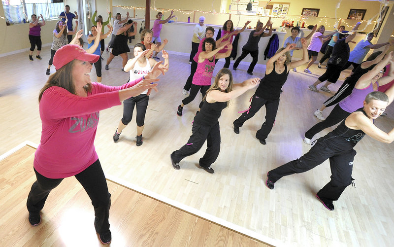 Susan Sinnett leads a fitness class at Studio Fit of Maine in Portland on Wednesday.