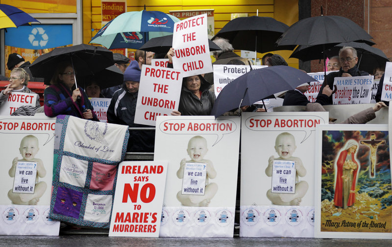 Protesters opposed to abortion hold placards Thursday outside the Marie Stopes clinic in Belfast, Northern Ireland, where the first abortion clinic on the island of Ireland has opened, sparking protests by both Catholics and Protestants.