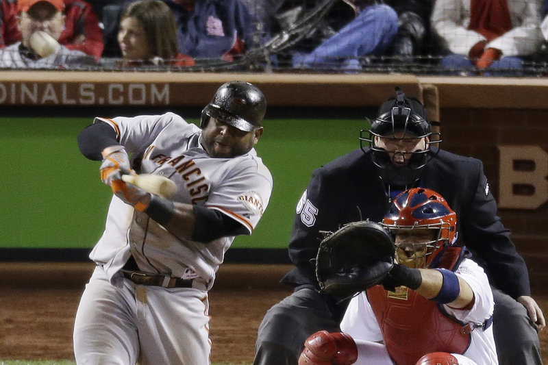 Pablo Sandoval of the Giants raps a home run in the eighth inning of Game 5 Friday in the National League Championship Series. The Giants won that game 5-0, setting up Game 6 in San Francisco. The series winner will play Detroit in the World Series.