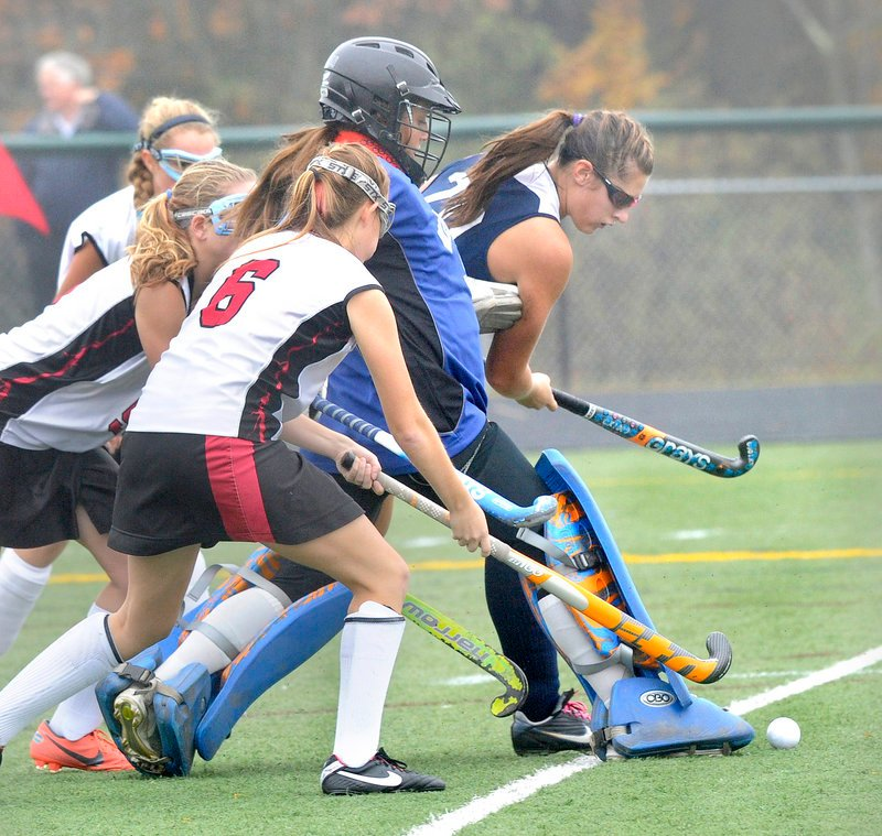Westbrook goalie Nicole Miranda attempts to clear the ball, helped by teammate Emily Blackmore, as Rachael Wallace of Scarborough, 6, reaches for the ball.