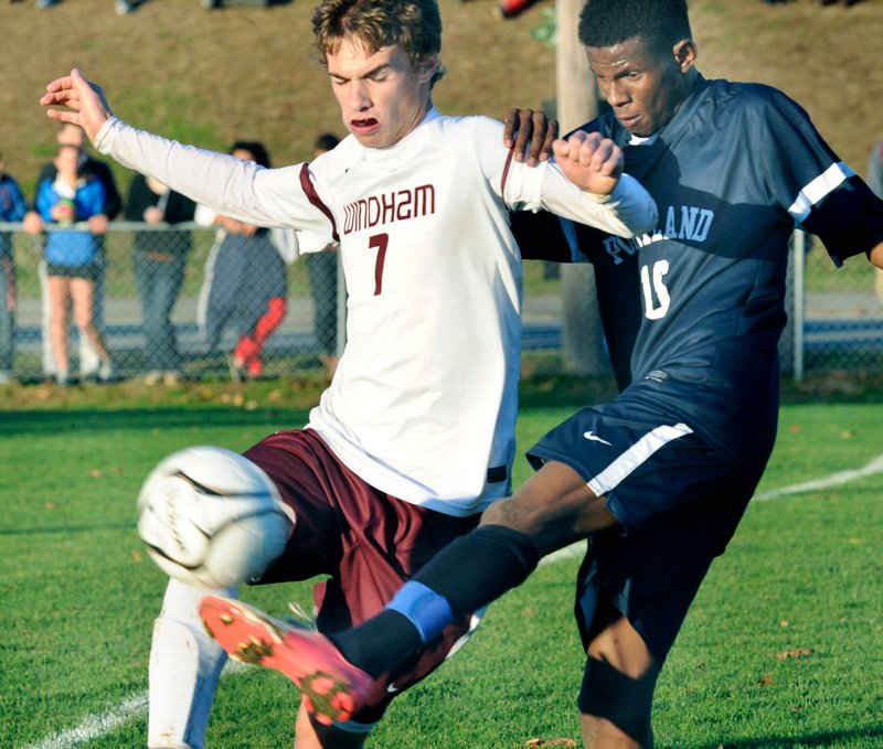 Ibrahim Dahir, right, of Portland kicks the ball away from Marc Reynolds, who scored the only goal for Windham.