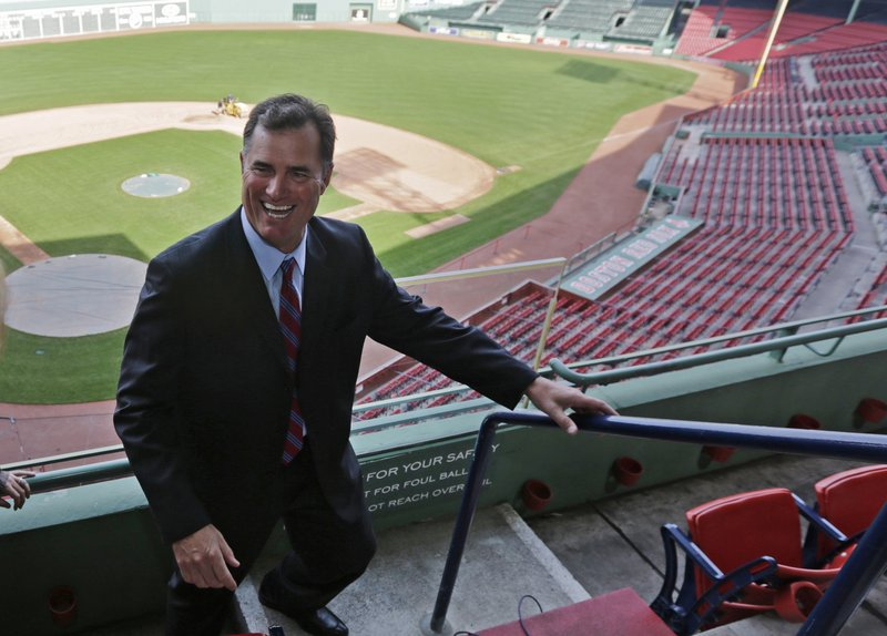 "John Farrell, the new manager of the Boston Red Sox, walks through the stands Tuesday at Fenway Park. Farrell, who became the 46th manager in the club's 112-year history, spoke glowingly of the ballpark and fans Tuesday, saying, ""Boston is, in my mind ... this is the epicenter of the game."""