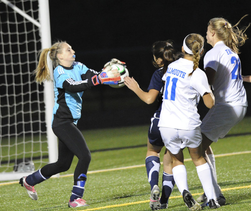 Yarmouth goalie Shannon Fallon, who had 13 saves in the game, comes out to make one of them in Tuesday's game at Falmouth. The No. 2 Yachtsmen advanced with a win, and will now host sixth-ranked Gray-New Gloucester in a semifinal on Saturday.