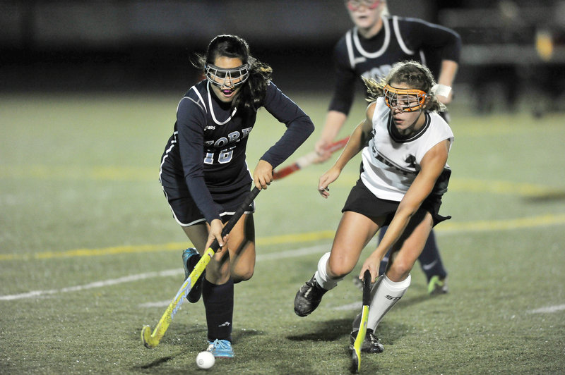 Olivia Drew of York, left, controls the ball and looks for a way around Sadie Rover of Leavitt during their Western Class B field hockey final Tuesday at Scarborough. Leavitt ended York's four-year reign, 1-0.