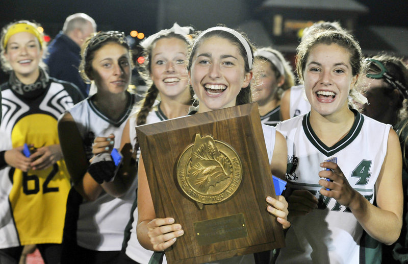 It used to be a common sight for the Leavitt High field hockey team, holding a championship plaque after each of its four regional title victories in the 1990s. But it hadn't happened since 1997. Until Tuesday, when the Hornets beat York 1-0 in Class B. Morgan Shaw holds the plaque.