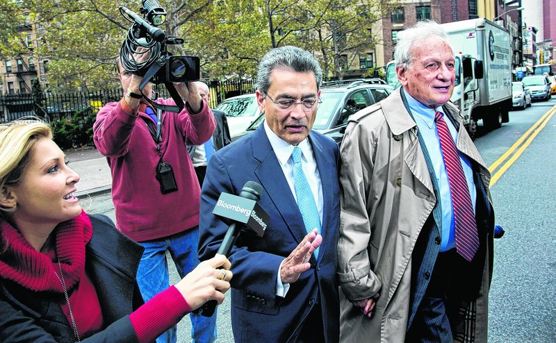 Former Goldman Sachs and Procter & Gamble Co. board member Rajat Gupta declines to answer a question from a reporter as he arrives Wednesday outside federal court in New York for his insider trading sentencing.
