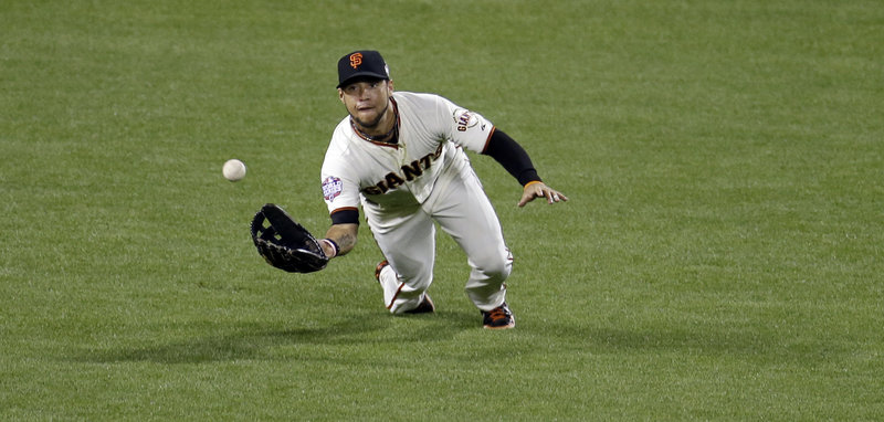 Left fielder Gregor Blanco of the San Francisco Giants races in to make a diving catch on a ball hit by Prince Fielder of the Detroit Tigers in the sixth inning of Game 1 of the World Series. The Giants came away with an 8-3 victory at home.