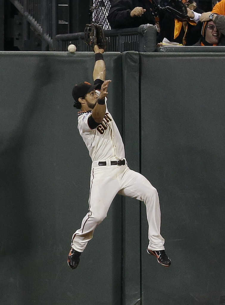 Angel Pagan, the center fielder for the San Francisco Giants, comes up just short of nabbing a two-run homer by Jhonny Peralta of the Detroit Tigers in the ninth inning of the World Series opener Wednesday night.