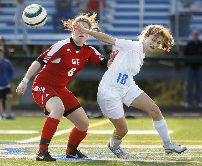 Alex Moeller, left, of Gray-New Gloucester, vies for the ball against Falmouth's Cassie Darrow in second-half action of Saturday's game in Falmouth.