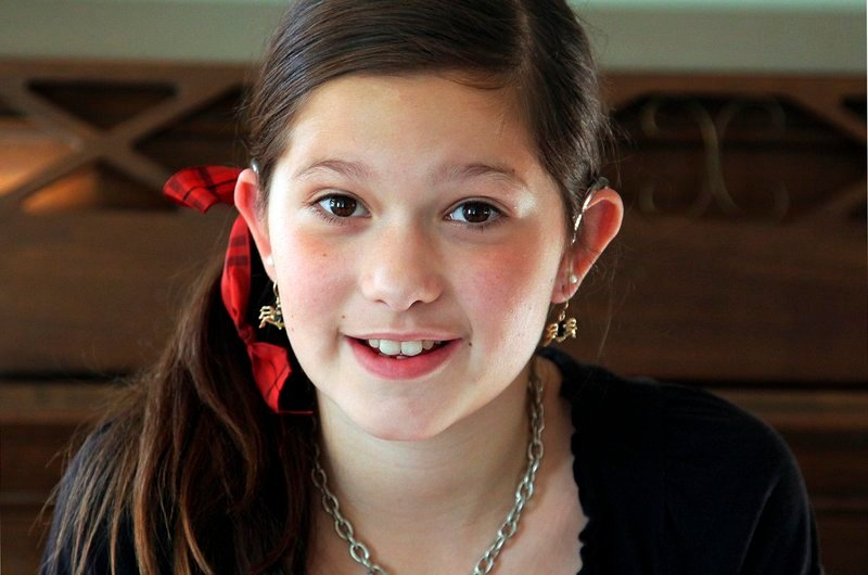 Elizabeth Merrick, 11, of Marshfield, Mass., testified last year to help children get coverage for hearing aids.