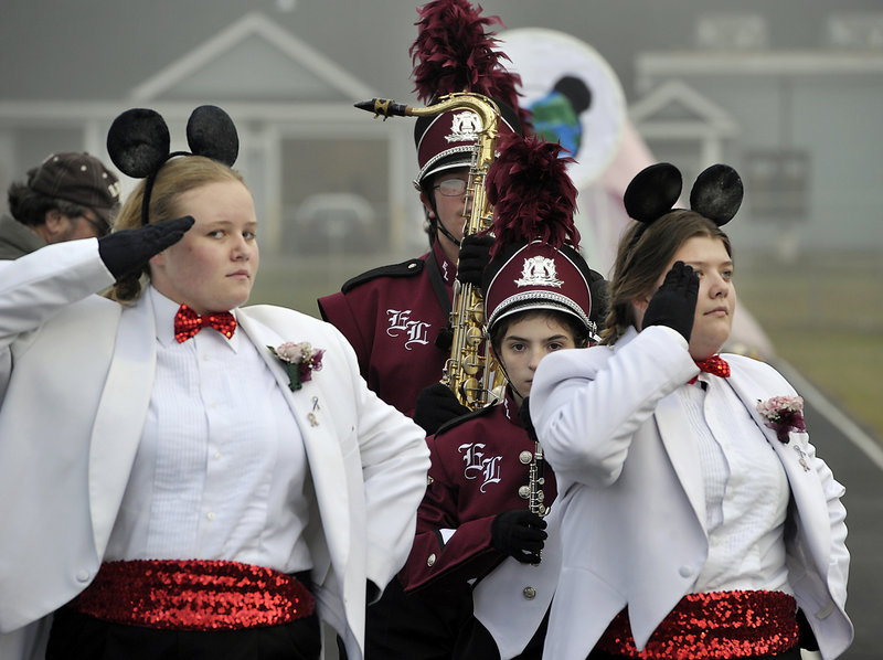 The Edward Little High School marching band leaves the field in step after its performance in Old Orchard Beach on Saturday. Each band's performance was rated by stars, from one to five.