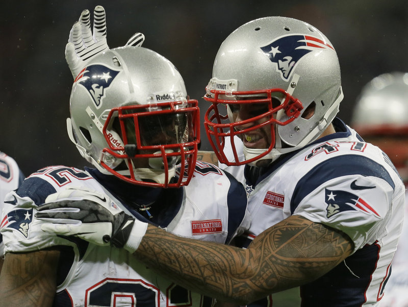 New England Patriots running back Stevan Ridley is congratulated by tight end Michael Hoomanawanui, after Ridley's touchdown against the St. Louis Rams on Sunday at Wembley Stadium in London. The Patriots improved to 5-3 as they head into a bye week.