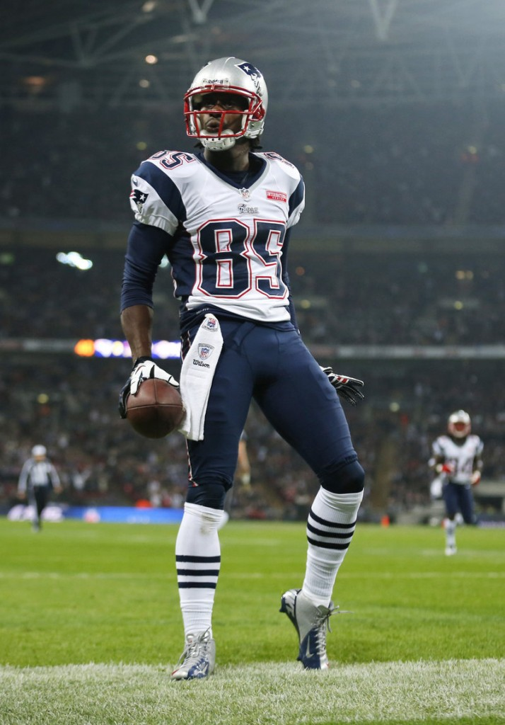 Patriots wide receiver Brandon Lloyd celebrates a touchdown reception in a 45-7 win over St. Louis at London's Wembley Stadium.