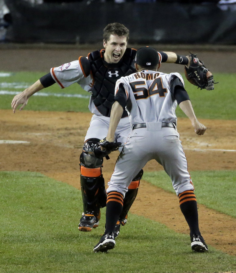 San Francisco reliever Sergio Romo, right, and catcher Buster Posey get ready to celebrate the Giants' clinching 4-3 World Series win on Sunday at Detroit. Romo struck out the side in the 10th inning to seal the win.