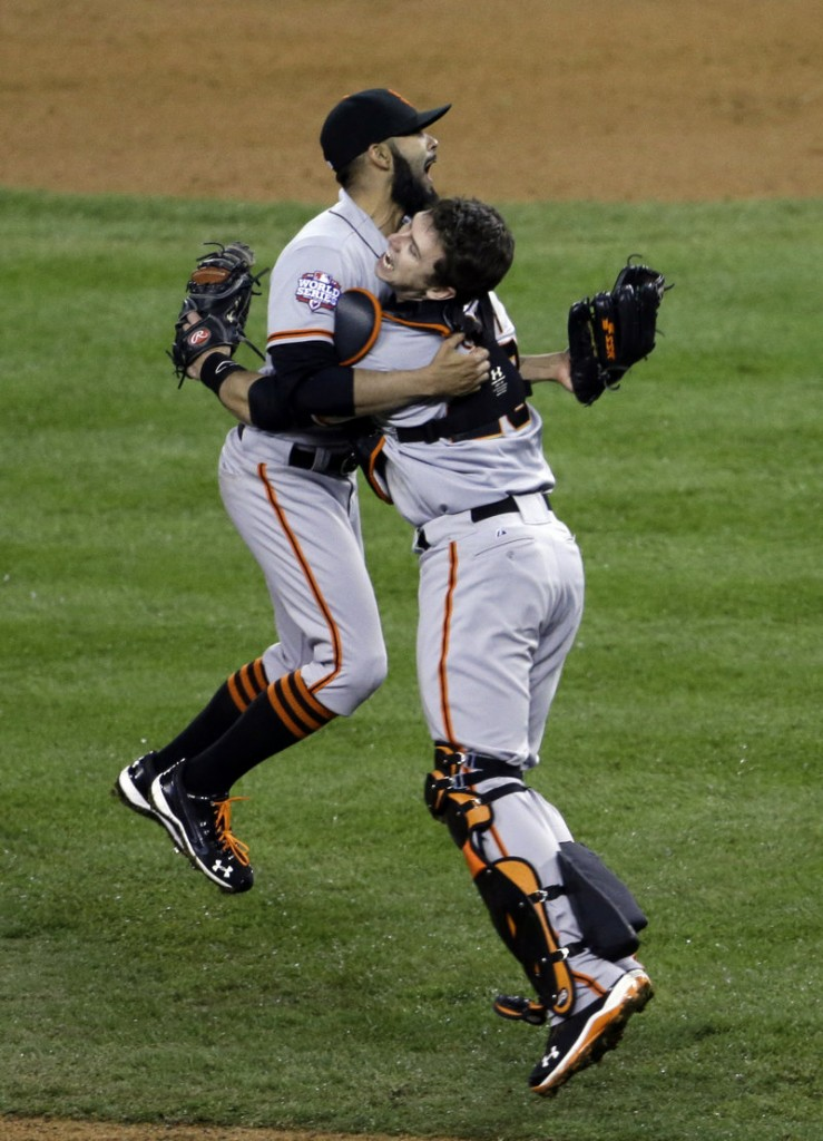 San Francisco Giant's catcher Buster Posey and pitcher Sergio Romo celebrate defeating the Detroit Tigers in Game 4.