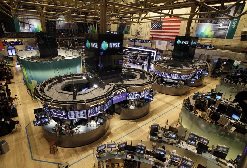 The floor of the New York Stock Exchange is empty of traders Monday in New York. Trading has rarely stopped for weather. A blizzard led to a late start and early close on Jan. 8, 1996, according to NYSE Euronext.