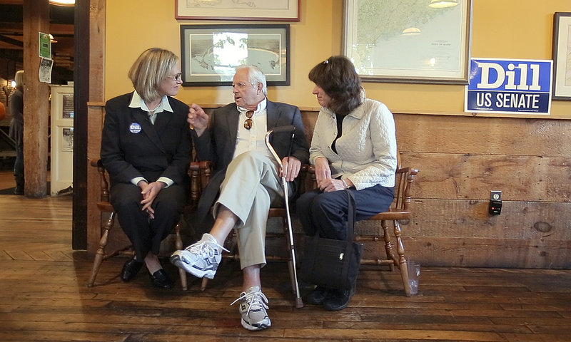 Cynthia Dill talks with Skip Clark, center, and Janet Saurman, right, at a campaign fundraiser at the Run of the Mill Public House in Saco last Friday. Dill has worked to dispel the idea that voting for her will help elect Republican Charlie Summers.