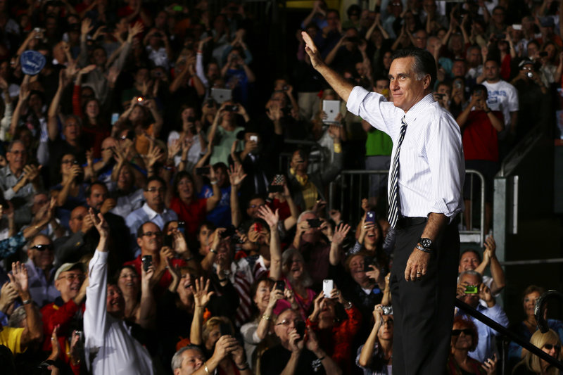 Mitt Romney waves during a campaign stop at the Bank United Center, at the University of Miami in Coral Gables, Fla., Wednesday.
