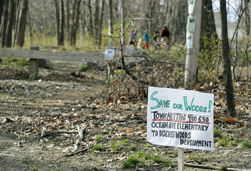 Neighbors of Canco Woods posted signs in April announcing a meeting to brainstorm ways to save their woods from industrial development. It has long been used as a park.