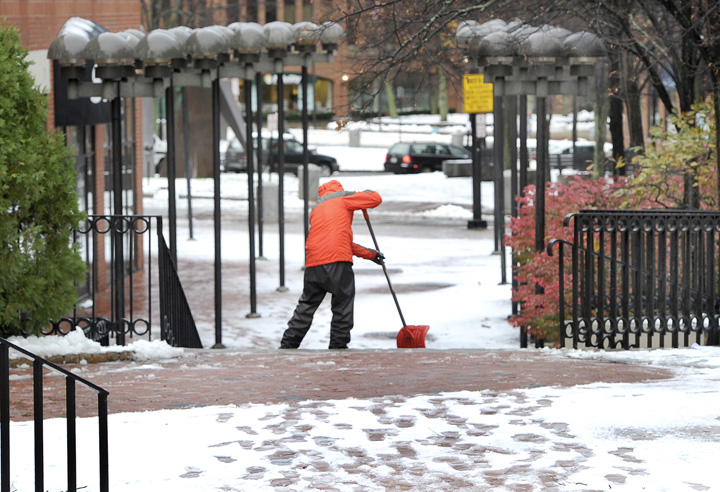Scott Woodward clears a path near One City Center on Thursday morning.