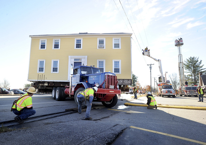 The historic Storer Garrison House is moves over utility lines that were lowered to allow its passage along Route 1 in Wells on Friday.