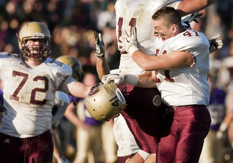 Thornton Academy players David LePauloue, left, and Josh Cyr celebrate after beating Cheverus in the Western Maine Class A football championship at Cheverus in Portland on Saturday.