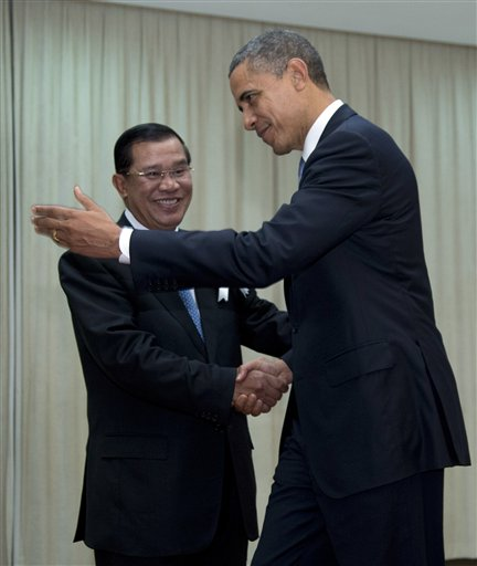 U.S. President Barack Obama is welcomed by Cambodia's Prime Minister Hun Sen as he arrives at the Peace Palace in Phnom Penh, Cambodia, Monday, Nov. 19, 2012. Obama will attend the East Asia Summit. (AP Photo/Carolyn Kaster)