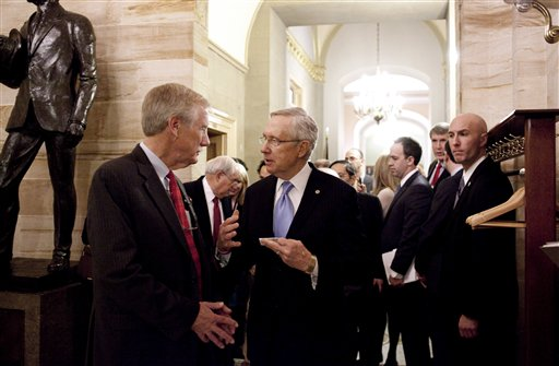 Sen.-elect Angus King, I-Maine, talks with Senate Majority Leader Harry Reid of Nev., on Capitol Hill in Washington, Wednesday, Nov. 14,2012, after King announced that he will caucus with the Democrats in the 113th Congress. (AP Photo/Harry Hamburg)