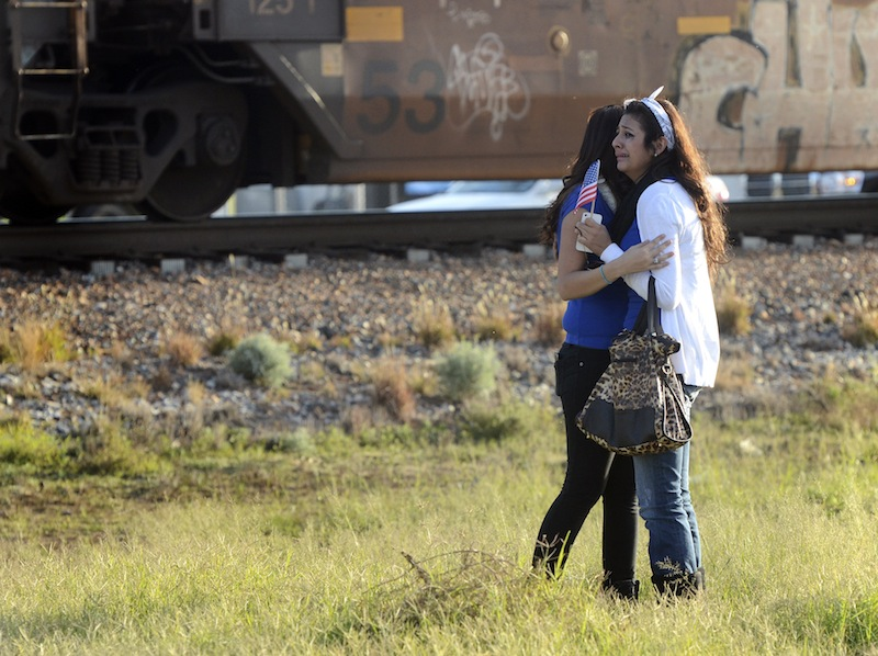 Parade participants react after a trailer carrying wounded veterans in a parade was struck by a train in Midland, Texas, Thursday, Nov. 15, 2012.
