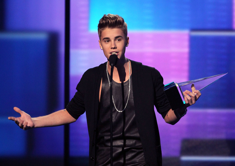 Justin Bieber accepts the award for favorite male artist - pop/rock at the 40th Annual American Music Awards on Sunday in Los Angeles.