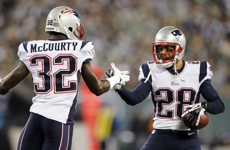 New England Patriots strong safety Steve Gregory (28) celebrates with teammates after intercepting a pass from New York Jets Mark Sanchez during the first half of an NFL football game, Thursday, Nov. 22, 2012, in East Rutherford, N.J. (AP Photo/Julio Cortez) NFLACTION12;