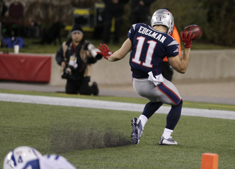 New England Patriots wide receiver Julian Edelman celebrates his touchdown against the Indianapolis Colts in the second quarter Sunday at Gillette Stadium in Foxborough, Mass. Gillette Stadium