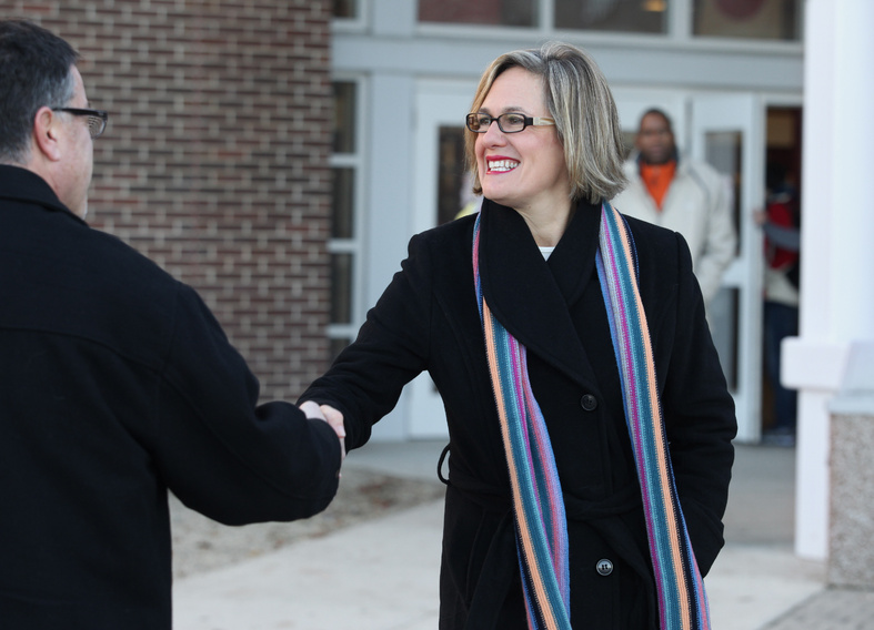 Democratic U.S. Senate candidate Cynthia Dill greets a voter Tuesday outside the polling place at Scarborough High School.