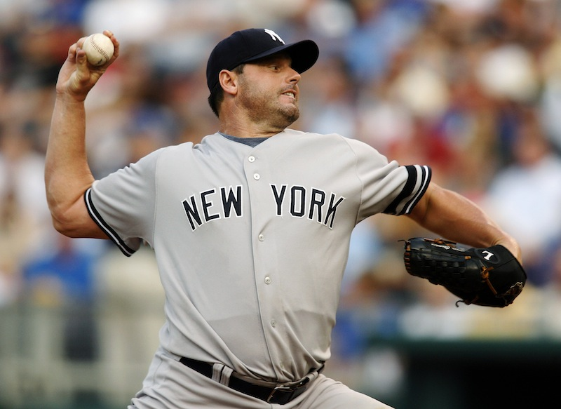 In this July 23, 2007, file photo, New York Yankees starting pitcher Roger Clemens throws against Kansas City Royals' David DeJesus in the first inning of a baseball game in Kansas City, Mo. Clemens, Barry Bonds and Sammy Sosa are set to show up on the Hall of Fame ballot for the first time on Wednesday, Nov. 28, 2012, and fans will soon find out whether drug allegations block the former stars from reaching baseball's shrine. (AP Photo/Ed Zurga, File)