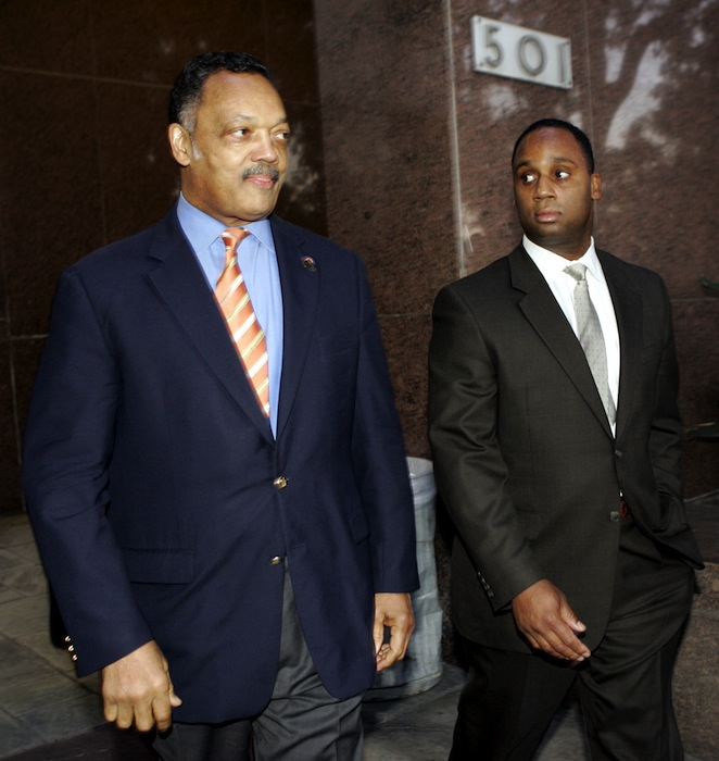 In this Jan. 19, 2006 The Rev. Jesse Jackson, left, and his son Jonathan leave Los Angeles Superior Court. At 71, Jackson Sr. still keeps a hectic schedule and speaks extemporaneously on civil rights issues of all kinds. But he struggles when addressing one thing: Jesse Jackson Jr., the son and heir to Jackson's political influence who abandoned his congressional seat last week because of mental health problems and two federal investigations. Jonathan Jackson, a Chicago State University business professor, is contemplating seeking the congressional seat vacated by Jesse Jr. (AP Photo/Ric Francis, File)
