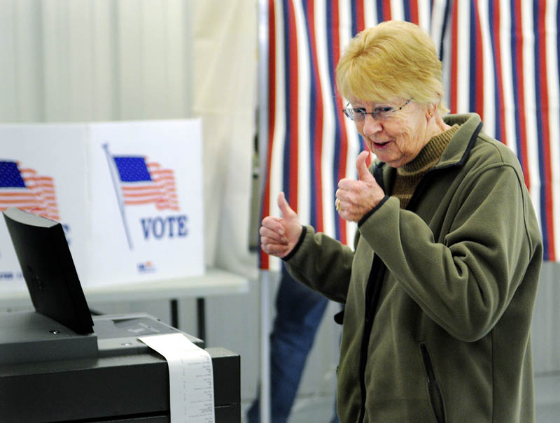 THUMBS UP: Joan Billings reacts to casting her ballot Tuesday at the polling place within the West Gardiner Fire Department.