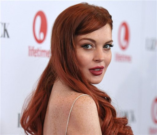 Actress Lindsay Lohan attends a dinner in Beverly Hills, Calif., in this Nov. 20, 2012, photo.