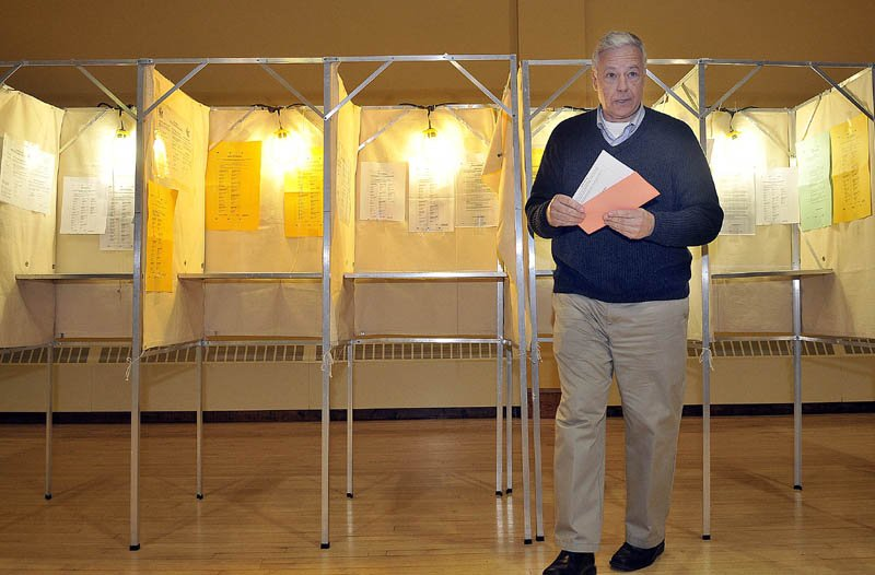 Staff photo by Michael G. Seamans Mike Michaud leaves the voting booth with his ballot at the East Millinocket Town Hall on Tuesday evening.