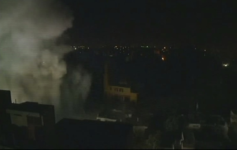 This image taken from AP video shows smoke rising from a building moments after an Israeli airstrike in Gaza City, early Wednesday, Nov. 21, 2012. Israel and the Hamas militant group edged closer to a cease-fire Tuesday to end a weeklong Israeli offensive in the Gaza Strip, but after a day of furious diplomatic efforts involving the U.S. secretary of state, U.N. chief and Egypt's president, a deal remained elusive and fighting raged on both sides of the border. (AP Photo/AP Video)